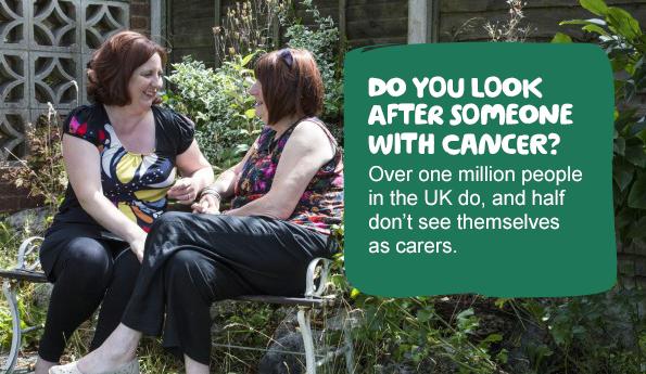 Two women talking in a garden
